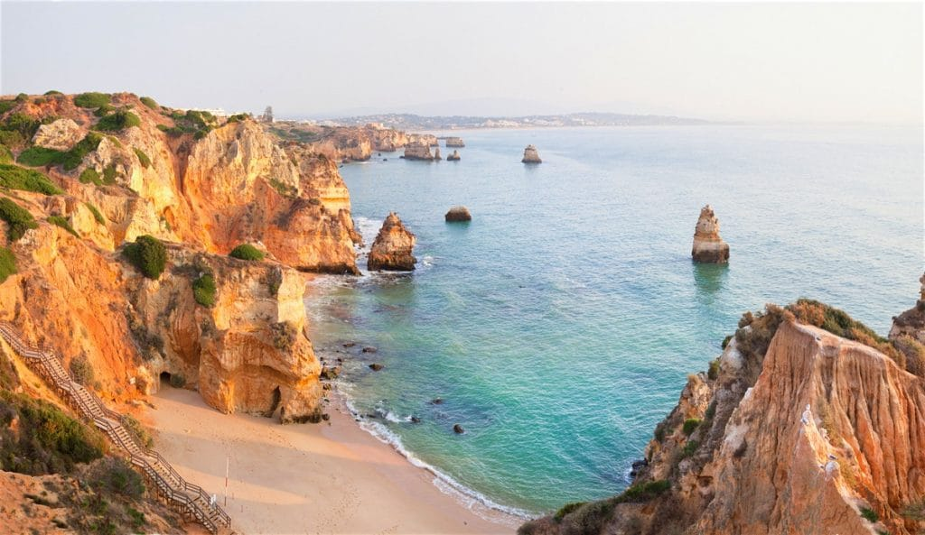 By renting a bike in Lagos, you can visit the dazzling red-yellow colored cliffs and beautiful beaches
