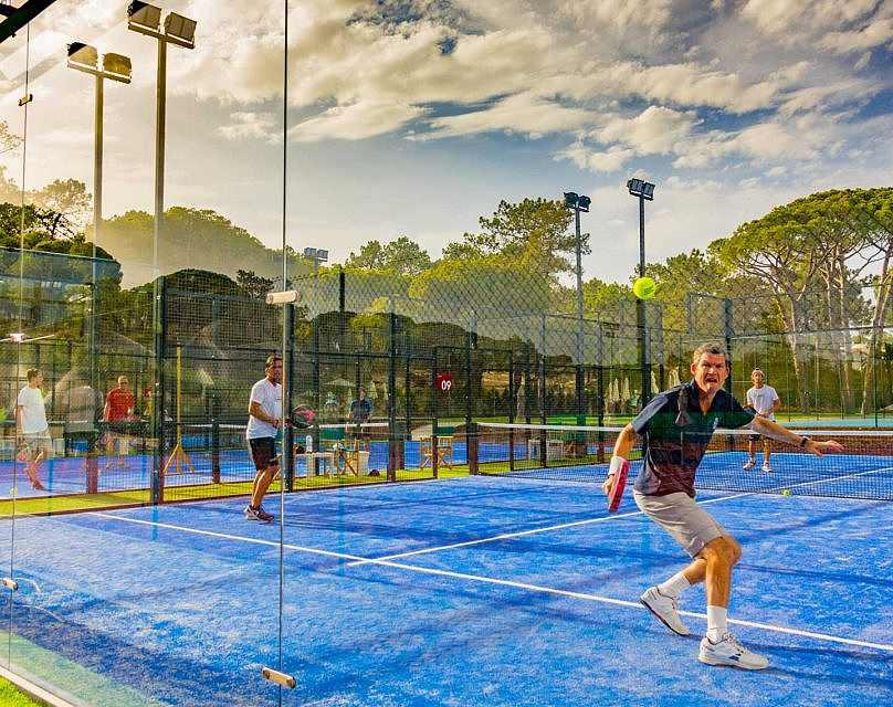 People playing tennis in a tennis court at Quinta do Lago
