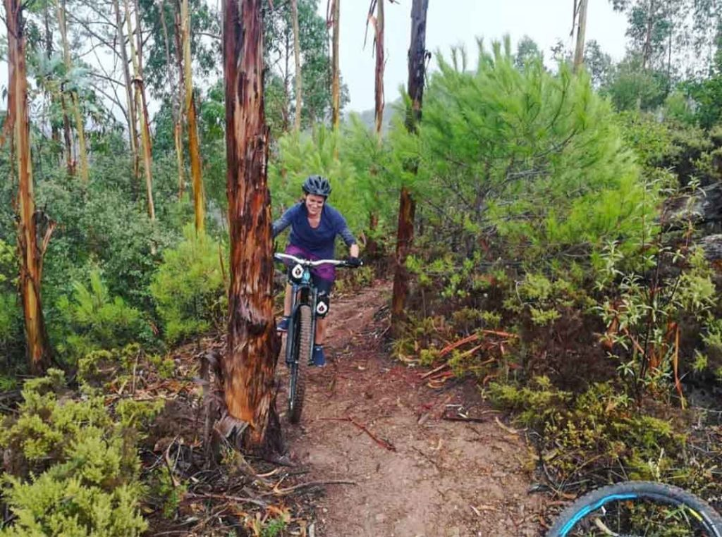 A woman is visiting Algarve and enjoying a mountain bike tour