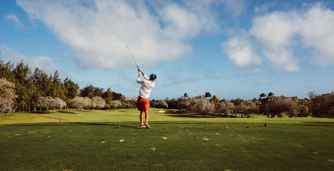 A person is playing golf, one of the amazing things to do in Almancil