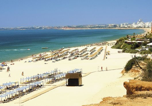 After renting a bike, you can ride in and around beautiful beaches in Vale do Lobo
