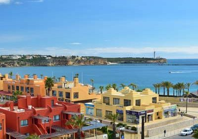 While renting a bike, you can also try to visit beach and sightsee colorful buildings in Portimão